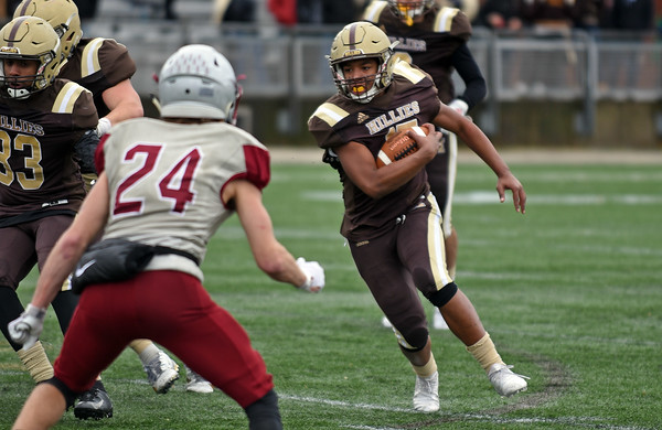 RYAN HUTTON/ Staff photo<br /> Haverhill's Jabari Baptiste looks for an opening during the third quarter of Thursday's Thanksgiving game at Trinity Stadium in Haverhill. Haverhill beat Lowell 28-7.