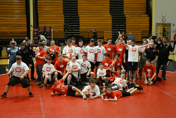 CARL RUSSO/Staff photo. The wrestlers and coaches gather for a group photo. The 6th. annual North Andover Wrestle 'Lympics was held Friday night at North Andover high school. High school varsity and middle school wrestlers competed against challenged wrestlers to benefit the Best Buddies program. 11/22/2019