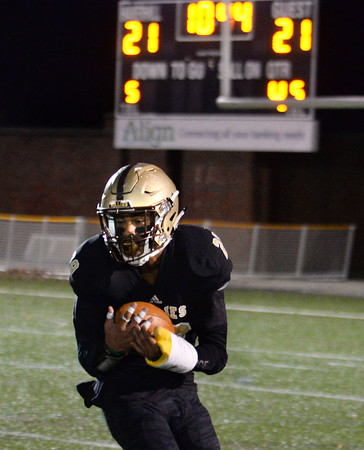CARL RUSSO/Staff photo. Haverhill's Disani Houston turns around to make the catch and pick up yardage before being tackled. The catch allowed Haverhill to score their 4th. touchdown on the next play. Haverhill defeated Lexington 42-28 in Friday night football action. 11/15/2019