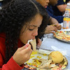 CARL RUSSO/Staff photo. Dereon Medina, 10 finishes his dinner.  Over 400 youth members of the Boys & Girls Club of Lawrence enjoyed a traditional Thanksgiving dinner with all the trimmings  Tuesday night. The dinner was donated and prepared by members of the Exchange Club of Lawrence and served by volunteers. The Exchange Club also donated a check for $2,000 to the Boys & Girls Club before the start of dinner. <br /> <br /> In addition, Executive Director Markus Fischer presented the club's 2020 Youth of the Year award to Joel Javier of Lawrence. He is a senior at the Greater Lawrence Technical high school majoring in Information Technology. <br /> <br /> Established in 1947, Youth of the Year is the Boys & Girls Club of America's premier recognition program for club members 14-18 years old who compete at the local, state, regional and national levels for college scholarships. The National Youth of the Year is installed by the President of the United States. 11/26/2019