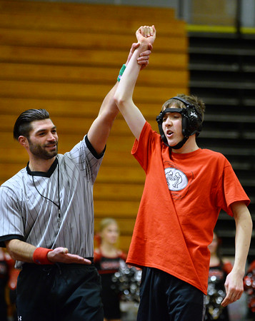 CARL RUSSO/Staff photo. Referee Stephen Cincotta, former North Andover high wrestler raises the arm of Dylan Welch, a senior at Westford Academy after winning his match. <br /> <br /> The 6th. annual North Andover Wrestle 'Lympics was held Friday night at North Andover high school. High school varsity and middle school wrestlers competed against challenged wrestlers to benefit the Best Buddies program. 11/22/2019