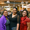 RYAN HUTTON/ Staff photo<br /> From left, Maria Medina, Jennifer Mezquila and Marisol Reyes from Northern Essex Community College at the GLOW Gala at Everett Mill in Lawrence on Thursday night marking the 20th anniversary of Groundwork Lawrence.