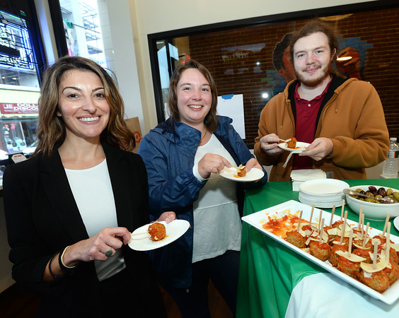 CARL RUSSO/Staff photo. From left, Thea Tsagaris of Haverhill, Sarah Wescott of Methuen and her brother Patrick Wescott of Hampton N.H. enjoy the meatballs covered with shaved parmesan cheese from La Pizza Di Forno located on Merrimack Street. <br /> <br /> The Exchange Club of Haverhill presented their annual Food, Fun and Flare from Around the World fund raiser on Thursday, June 13. Proceeds from this springtime fundraiser benefited Haverhill's local Boys & Girls Club, YMCA, YWCA in addition to Exchange Club. <br /> <br /> The unique event stimulated taste buds with foods from across the globe: China, Greece, France, Italy, Mexico and southern United States to name a few. <br /> <br /> The 13 restaurants that participated are: G's,  Mark's Deli, Keon's 105 Bistro, Battlegrounds Coffee Co., The Lasting Room, Wang's Table, Hans Garden, La Pizza Di Forno, Olivia's, Butch's Uptown, Maria's Family Restaurant, The Peddler's Daughter and Casa Blanca. Each  restaurants featured ethnically-themed small plates from different areas of the world. 6/13/2019