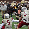 RYAN HUTTON/ Staff photo<br /> Haverhill quarterback Brady Skafas runs the ball in for a touchdown during the third quarter of Thursday's Thanksgiving game at Trinity Stadium in Haverhill. Haverhill beat Lowell 28-7.