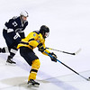 CARL RUSSO/Staff photo. Merrimack's Zach Vinnell moves the puck as Penn State's Sam Sternschein gives chase. Merrimack College was defeated by Penn State in men's hockey Friday night. 11/29/2019