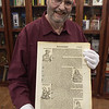 TIM JEAN/Staff photo <br /> <br /> Frank Romano, of the Museum of Printing holds up a page from the Nuremberg Chronicle on display at the museum in Haverhill.      11/14/19