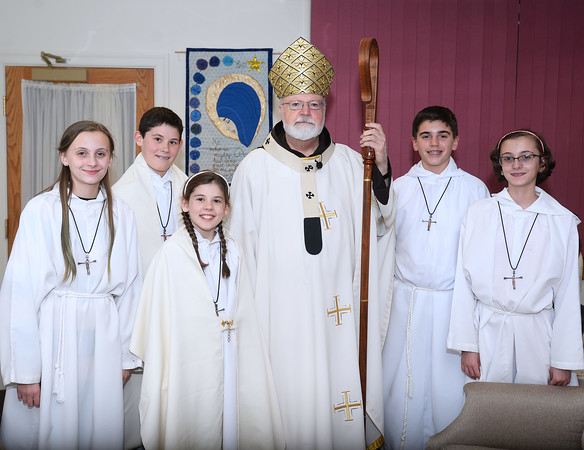 CARL RUSSO/staff photo. Cardinal Sean P. O'Malley, OFM Cap. poses for a photo with St. Michael's altar servers whom are all parishioners before the mass. Left to right:<br /> Norah Moore, Ben Masterson, Annie Masterson, Chris Savino and Cali Moore. The Masterson's are St, Michael students.<br /> <br /> Cardinal Sean P. O'Malley, OFM Cap. celebrated mass Tuesday night at St. Michael's Parish in honor of their 150th anniversary. 11/19/2019