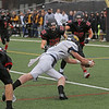 MIKE SPRINGER/Staff photo<br /> Andover linebacker Shamus Florio prepares to dive into the endzone for a touchdown in the second quarter of the Thanksgiving Day game Thursday at North Andover.<br /> 11/27/2019