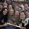 MIKE SPRINGER/Staff photo<br /> The Andover High School swim team celebrates its championship Sunday in the state Division 1 finals at the MIT pool in Cambridge. Holding the trophy are the four captains, from left, Ella Reck, Lauren Bessette, Emily Clements and Emily Ma.<br /> 11/17/2019