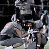 TIM JEAN/Staff photo <br /> <br /> Greater Lawrence players Tiago Fernandes (6) Maleek Dejesus (2) and Shamil Diaz react to losing 33-32 to Abington in the Division 7 semifinal football game in Woburn.  11/23/19