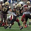 RYAN HUTTON/ Staff photo<br /> Haverhill's Disani Houston tries to push through a Lowell tackle during the fourth quarter of Thursday's Thanksgiving game at Trinity Stadium in Haverhill. Haverhill beat Lowell 28-7.