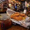 RYAN HUTTON/ Staff photo<br /> The Peddler's Daughter serves fish and chips the traditional Irish way, wrapped in newspaper. The pub also serves it with handmade ketchup and tartar sauce.
