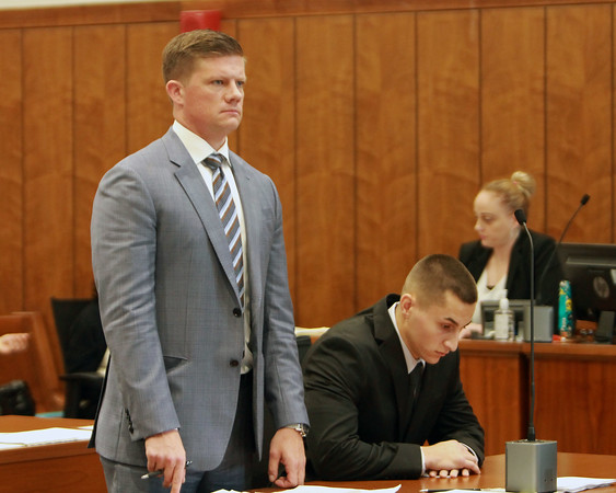 MIKE LABELLA/ Staff photo<br /> Owen Foote, 20, right, looks down as his attorney Benjamin Urbelis, left, addresses the judge in Haverhill District Court on Tuesday during a change of plea hearing.