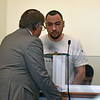 RYAN HUTTON/ Staff photo<br /> Giovanni Lebron, of Lawrence, speaks to his attorney in Essex County Superior Court in Salem on Wednesday to face murder charges in the July death of 24-year-old Nicole Connor.