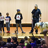 RYAN HUTTON/ Staff photo<br /> Andover Police Sgt. Steven Gerroir, right, holds on to the lead of Peaches the miniature horse during an anti-bullying presentation on stage at High Plain Elementary School. Joining him are students, from left, fifth grader Adelaide Buzay, second grader Akshanan Thiraviyarajah, first grader Maxwell Njenga, and fifth grader Rayna Cozzaglio.
