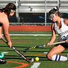 CARL RUSSO/Staff photo Andover captain, Hanna Medwar goes down fighting for the ball with North Andover's Kiki Valentino. Andover and North Andover battled to a 1-1 tie in field hockey action Wednesday afternoon.10/23/2019