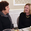 TIM JEAN/Staff photo<br /> <br /> Karen Frederick, left, CEO Community Teamwork, talks with al Grid, during the Merrimack Valley Chamber of Commerce annual Women in Business Conference. The luncheon held at Michael's Function Hall, and featured speaker was Congresswoman Lori Trahan.   10/25/19