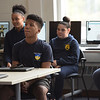 TIM JEAN/Staff photo<br /> <br /> Spark Academy students listen to Bob Sweeney, Boston Bruins Foundation President in the new STEM lab at the school.  The Boston Bruins Foundation and in Partnership with Red River Charitable Foundation built the state of the art STEM lab for the school.     10/25/19