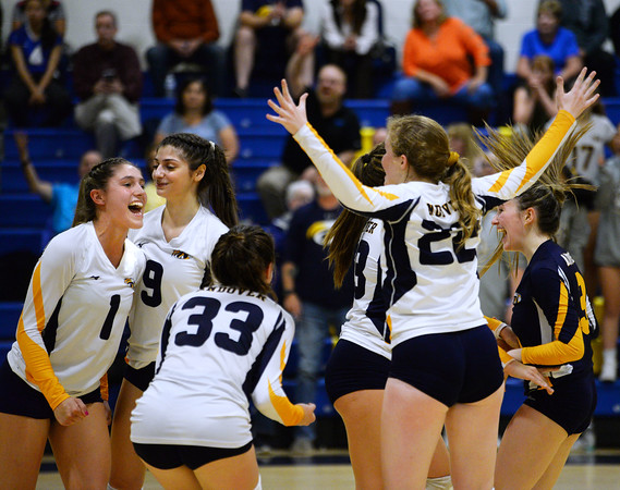 CARL RUSSO/Staff photo Andover's Sophia Martinez, 1, Brooke Abouhamad, 9, Alexandra Papazian, 33, Hannah Goff, 22, Caroline Fraser (hidden) and Jenny McNaughton, far right, celebrate the victory. Andover defeated Methuen in the 5th. game of volleyball action at Andover high. 10/7/2019