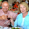 """CARL RUSSO/Staff photo. Michael Smolak, owner of Smolak's Farms in North Andover and his sister Carol Leary of North Andover offer a toast while attending the WHIM dining experience. Executive chef Nick Deutmeyer of Post 390 in Boston's Back Bay was featured on July 10.    <br /> <br /> Smolak Farms holds a weekly """"pop up"""" dining experience every Wednesday evening through the summer. The farm invites New England chefs to cook a multi-course dinner in the Smolak Farms Pine Grove using produce grown at the farm, creating their menus on a """"WHIM."""" Executive chef Nick Deutmeyer of Post 390 in Boston's Back Bay was featured on July 10.     7/10/2019"""