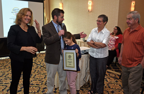 """RYAN HUTTON/ Staff photo <br /> Carter's Ice Cream owner Jeremy Dinan, center left, thanks his parents for all their help as he and his daughter accept  the Best of the Eagle-Tribune Award for """"Best Ice Cream"""" during the awards breakfast at the Atkinson Country Club on Wednesday morning. At left is Eagle-Tribune publisher Karen Andreas."""