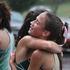 MIKE SPRINGER/Staff photo<br /> Finleigh Simonds of Haverhill is congratulated by another runner at the finish line in a cross country meet Wednesday with Central Catholic and Billerica at Winnekenni Park in Haverhill. <br /> 10/02/2019