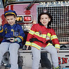 TIM JEAN/Staff photo<br /> <br /> Mason and Levi Butterworth, of Methuen, sit on the fire departments Engine 1 during the second annual Methuen Day in downtown Methuen in coordination with the Methuen Fire and Police Departments Open Houses.   10/5/19