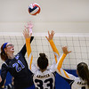 CARL RUSSO/Staff photo Methuen's Megan Levesque spikes the ball over the net. Andover defeated Methuen in the 5th. game of volleyball action at Andover high. 10/7/2019