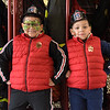 TIM JEAN/Staff photo<br /> <br /> Victor A. Martines, 6, left, and his brother Victor F. Martinez, 5, of Lawrence, flex their muscles as the stand near the firefighters turnout gear during the Lawrence Fire Department open house Saturday morning.   10/12/19
