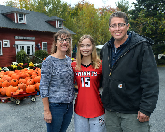 CARL RUSSO/Staff photo Laura with her parents, Ben and Cheryl Farnum. Laura Farnum is a senior standout volleyball player at North Andover high and her family  owns Boston Hill Farm in North Andover which has farmed there since the 1600s. 10/17/2019