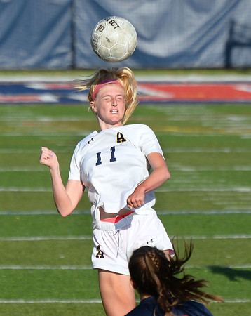 CARL RUSSO/Staff photo Andover's Ava Trapp heads the ball. Central Catholic defeated Andover 3-0 in girls soccer action Monday afternoon. 10/14/2019