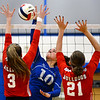 CARL RUSSO/Staff photo. Salem captain, Kristen Carney spikes the ball over the net. Salem Blue Devils were defeated by the Bedford Bulldogs three games to one in volleyball tournament action Thursday night. 10/31/2019