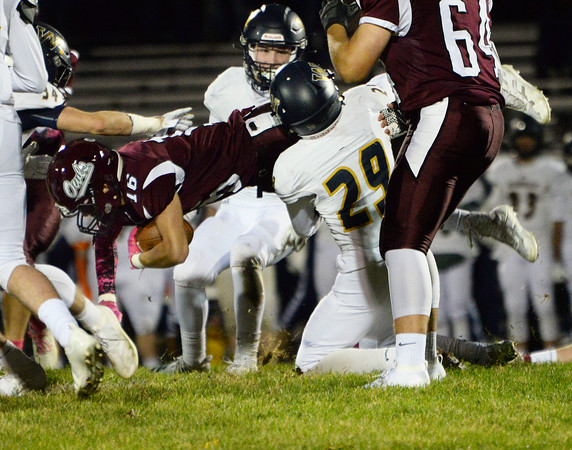 CARL RUSSO/Staff photo Windham's Stephen Mague, 29 takes down Timberlane's Evan Sapienza as he leaps foward. Windham defeated Timberlane 17-14 in football action. 10/18/2019