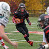 RYAN HUTTON/ Staff photo<br /> North Andover's Freddy Gabin looks for an opening as he carries the ball downfield during the first half of Friday's home game against Billerica.
