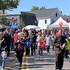 TIM JEAN/Staff photo<br /> <br /> Hundreds of people flooded Hampshire Street and visited the information booths during the second annual Methuen Day in downtown Methuen. 10/5/19