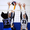 CARL RUSSO/Staff photo Andover's Sophia Martinez, left and Marissa Kobelski defend at the net as Methuen's Rachel Batista spieks the ball over. Andover defeated Methuen in the 5th. game of volleyball action at Andover high. 10/7/2019