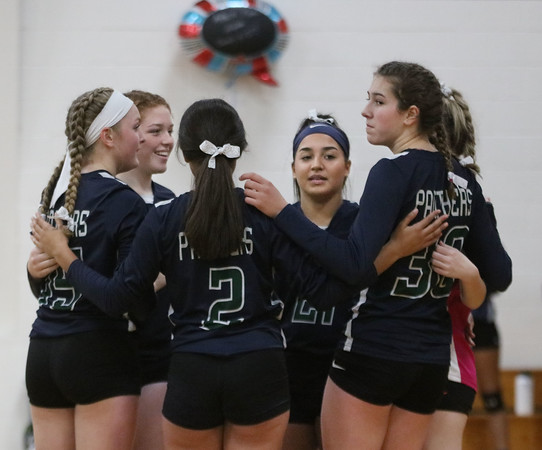 MIKE SPRINGER/Staff photo<br /> Stephanie Moreau, right, joins with her teammates at Presentation of Mary during varsity volleyball play Thursday against Nashoba Valley Tech in Methuen.<br /> 10/24/2019