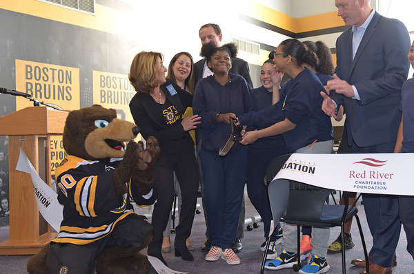 TIM JEAN/Staff photo<br /> <br /> Cutting the ceremonial ribbon for the new STEM lab at the Spark Academy in Lawrence, from left to right, Boston Bruins mascot, Blades the Bruin, Lieutenant Governor, Karyn Polito, Odanis Hernandez, Director Of Strategic Initiatives at Lawrence Public Schools, and Spark Academy students Alexya Avila, with scissors, Anais Mendez, and Arwen Francisco, all 13, Bob Sweeney, Boston Bruins Foundation President and in back Dan McGee, Red River COO. The Boston Bruins Foundation and in Partnership with Red River Charitable Foundation built the state of the art STEM lab for the school.     10/25/19