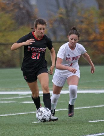 MIKE SPRINGER/Staff photo<br /> North Andover's Katie Wojcik, left, moves the ball upfield ahead of Olivia Guerriero of Masconomet during varsity soccer play Monday in North Andover.<br /> 10/28/2019