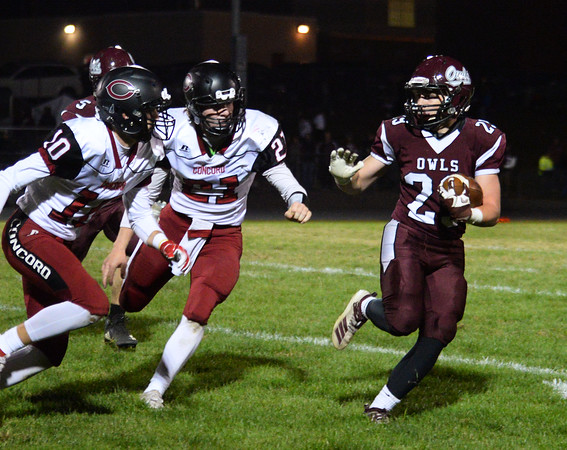 CARL RUSSO/Staff photo Timberlane's Daniel Post looks for avoid the tackle by Concord defenders. Concord defeated Timberlane 28-14 in Friday night football action. 10/4/2019
