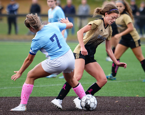 CARL RUSSO/Staff photo Haverhill's Meggie Dellea battles with Dracut defender to move the ball in scoring position. Haverhill defeated Dracut 2-1 in girls soccer action Tuesday afternoon. 10/8/2019