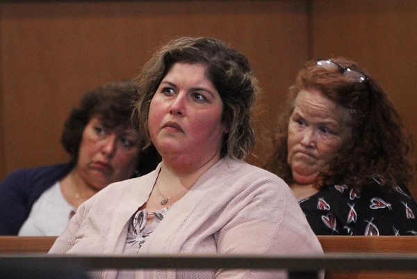 MIKE SPRINGER/Staff photo<br /> Tania Gonzalez, who was displaced from her South Lawrence home for four months following the September, 2018, gas disaster, listens during a hearing Monday in Salem Superior Court concerning the proposed $143 million settlement with Columbia Gas. Gonzalez thinks the settlement is not enough.<br /> 10/07/2019