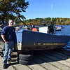 "RYAN HUTTON/ Staff photo<br /> Richard ""Rocky"" Morrison, head of the Clean River Project, stands with the Lawrence Community Boating Program boat his team helped find and raise from the bottom of the Merrimack River on Monday morning after it sank during last week's nor'easter."