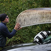 MIKE SPRINGER/Staff photo<br /> Chris Sullivan of Andover puts his canoe back on the car before beginning the bicycling segment of the 2nd Annual Andover Scramble on Sunday. <br /> 10/06/2019