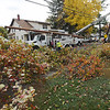 TIM JEAN/Staff photo<br /> <br /> National Grid works to install a new utility pole after a tree uprooted and fell across Vermont Street in Methuen. High winds and rain overnight caused major damage throughout the Merrimack Valley.     10/17/19