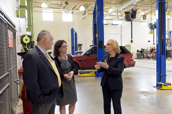 TIM JEAN/Staff photo<br /> <br /> Sen. Maggie Hassan, right, talks with Christopher Dodge, left, Director of the Salem's Career and Technical Education, and Tracy Collyer, Principal of Salem High School during a tour of the CTE areas.     10/4/19