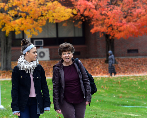 """CARL RUSSO/Staff photo Grand students: Sharon Montalvo and her granddaughter, Destiny Emanuel, are students at Northern Essex Community College. Both are enrolled in business courses. Montalvo, who was working as a manager at a call center before she was laid off in December 2017, said she is """"leaning"""" toward pursuing a bachelor's degree. Emanuel's goal is to start her own hair salon. Montalvo and Emanuel live in Haverhill.10/22/2019"""