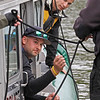 MIKE SPRINGER/Staff photo<br /> Lawrence Police Officer Zach Taylor reaches for a line as Officer Joe Lamagna of the Andover Police Department looks on Thursday during training exercises with the Massachusetts Environmental Police on the Merrimack River near the Abe Bashara Boathouse in Lawrence.<br /> 10/08/2019