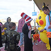 TIM JEAN/Staff photo<br /> <br /> Jerry Kozicz, right, owner of Geekster, passes out candy to children during the Downtown Business Trick-or-Treating in Derry.  10/26/19