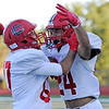 TIM JEAN/Staff photo<br /> <br /> Central's Anthony Rizkallah, left, celebrates with George Chaya after he scored a touchdown against Andover. Central won 41-10.   10/5/19